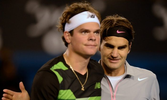 Milos Raonic (L) and Roger Federer meet at the end of the fourth round match at the Australian Open on Monday. Federer advanced to the quarterfinals. (Greg Wood/AFP/Getty Images)