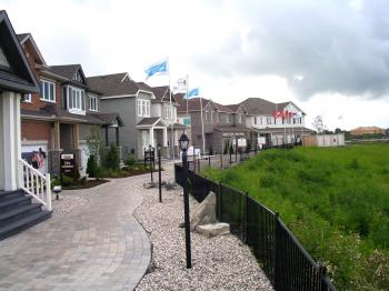 WIRED AND CONNECTED: Models of the connected singles, executive townhomes, and semi-detached homes being built by Monarch, Tartan, and Valecraft in the Kanata Smart Community neighbourhood of Sohowest in the west end of Ottawa. (Cindy Chan/The Epoch Times)
