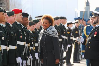 Governor General Michaelle Jean inspects the 100-person Guard of Honour after arriving on Parliament Hill to deliver the throne speech. (NTDTV)