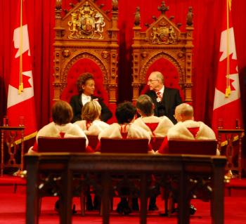 Governor General Michaelle Jean and her husband Jean-Daniel Lafond are seated in the Senate Chamber prior to the speech from the throne ceremony on March 3, 2010. (NTDTV)