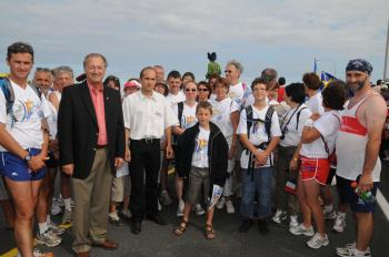 TWINNING WITH FRANCE: Among the events at the 2009 World Acadian Congress was a race from Shippagan to Miscou, featuring runners from Loudun, France, which is the twinned community of Shippagan. Hedard Albert, New Brunswick Minister of Wellness, Culture and Sport and minister responsible for la Francophonie (front, second from left), is pictured with some of the Loudun runners. (Province of New Brunswick)
