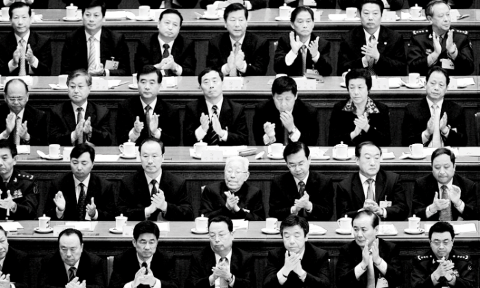 Chinese delegates applaud the result of a vote during the Chinese Communist Party Congress at the Great Hall of the People on October 21, 2007, in Beijing. (Andrew Wong/Getty Images)