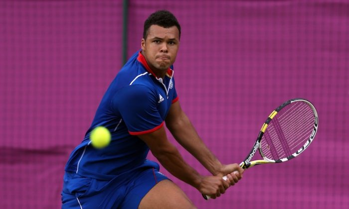 Jo-Wilfried Tsonga won a historic match against Canada's Milos Raonic in Olympic men's tennis on Tuesday. (Clive Brunskill/Getty Images)