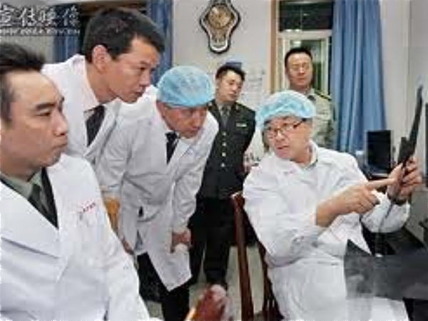 Wang Lijun is pictured showing military officials through his laboratory