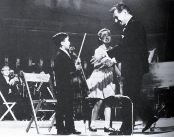 THE BIG BREAK: Yo Yo Ma (at age 7), with his sister Yeou-Cheng Ma, is congratulated by Leonard Bernstein at the Kennedy Benefit Concert in Washington, D.C., attended by President Kennedy and wife Jacqueline. (Courtesy of Marina Ma)