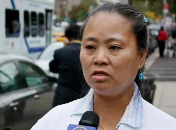 Zhang Derong was allegedly attacked by He Xu in Flushing last year, and has taken the case to court. She stands outside the Queens County Criminal Court on Oct. 13. (Matthew Robertson/The Epoch Times)