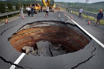 A sinkhole occurred on June 4 on a freeway in China's Zhejiang Province. (Photographer name withheld by request)