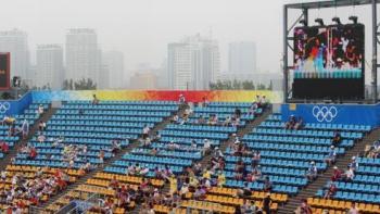 Empty Seats and Flashy Olympics