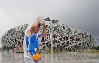 The Bird's Nest in Beijing.  The China Meteorological Administration (CMA) is predicting a 40 percent chance of rain the day of the Olympics' opening ceremony. (AFP/Getty Images)