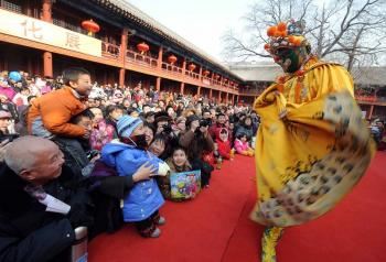 The traditional Chinese buffoon delights children and the young-at-heart. (AFP/Getty Images)