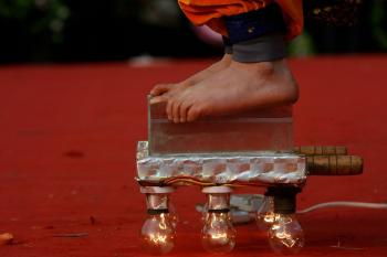 A closer look at the blades and light bulbs that support this folk artist. (AFP/Getty Images)