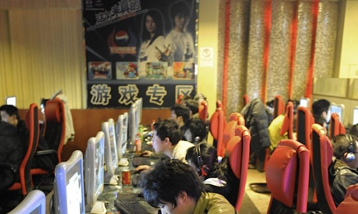 Young men use computers at an internet cafe in Beijing. The United States could leverage trade and technology to help counter censorship and surveillance in China enabled through that same trade and technology, said a panel hosted by the Congressional-Executive Commission on China. (Liu Jin/AFP/Getty Images)