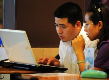 Chinese netizens use a laptop computer at a wireless cafe in Beijing in 2009.Chinese netizens speculated that the crackdown may be a silencing tactic ahead of the 18th National People's Congress to be held later this year. (Frederic J. Brown/AFP/Getty Images)