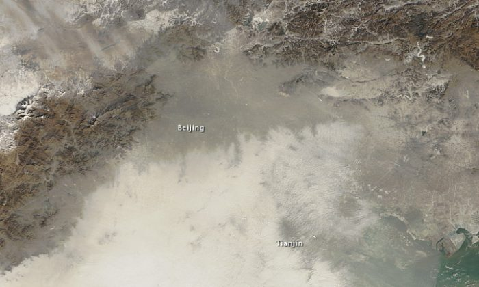 A NASA satellite image taken Jan. 14 showing the extent of pollution covering Beijing and outlying areas. (NASA)