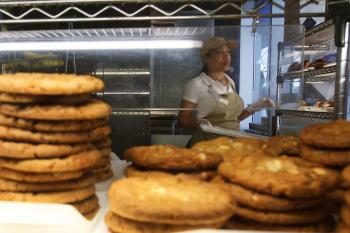 A woman puts out pastries and cookies at an Au Bon Pain store on July 01, 2008 in New York City. New York City has become the first U.S. city to ban trans fat, now California is planning to become the first U.S. state.  (Spencer Platt/Getty Images)