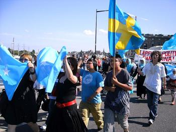 Ms. Dilala Reheman, a witness of the July 5, 2009 violence, participates in a protest in Sweden on July 5, 2010. (Courtesy of Dilshat Rishit)