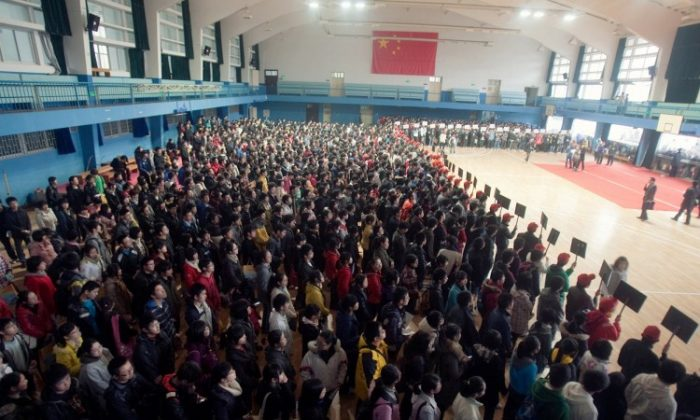 Students get ready for a college entrance exam in Wuhan, China in February 2011. Recently, China released new residency and work requirements for migrant workers which will make it harder for their children to go to college.
