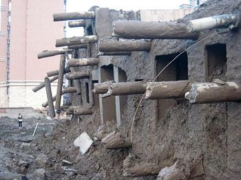 Broken foundation supports jut from the base of the fallen building. (Internet photo)