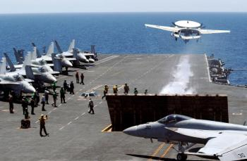 A U.S. fighter takes off from the flight deck of USS George Washington during a joint military exercises at east sea on July 26, 2010 in South Korea. (Song Kyung-Seok-pool/Getty Images)