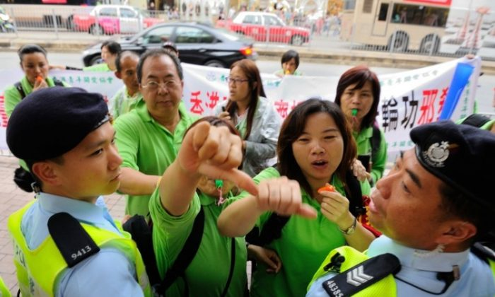The attack campaign against Falun Gong in Hong Kong is reminiscent of attacks against groups targeted during China's Cultural Revolution. (The Epoch Times)