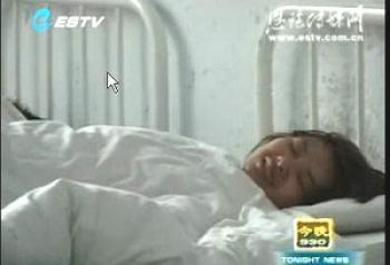 Deng is tied to a bed in a mental hospital (Screen grab from Enshi City TV/The Epoch Times)