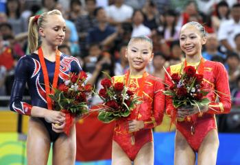 Information documenting He Kexin's (centre) age is fast disappearing from the Internet.   (Kazuhiro Nogi/AFP/Getty Images)