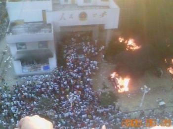 Nearly ten thousand angry people attack the County government building and set fire to the public security bureau office after a female student was raped and killed in Wenan County, in the Guizhou Province of China . (The Epoch Times)