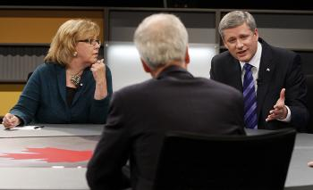 Canadian Prime Minister Stephen Harper (R) makes a point to Liberal leader Stephane Dion (C) as Green Party leader Elizabeth May looks on during the debate.  (Chris Wattie/AFP/Getty Images)