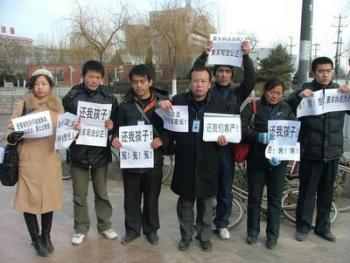 Parents of melamine-tainted milk powder victims banded together to safeguard the rights of Chinese babies.  (Rights Movement)