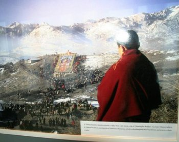 HARMONY IN TIBET? An image at the exhibit held at the U.N. on International Human Rights Day depicts a Tibetan Buddhist monk viewing a religious ritual. The Communist Party's purpose in displaying such imagery is to depict religious and ethnic harmony in Tibet, where human rights groups and Tibetans say that their religion has been attacked and undermined by the Party for over six decades. (UN Watch)