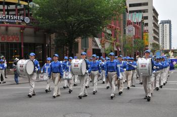 The Tian Guo Marching Band marches through Calgary's Chinatown (Jerry Wu/The Epoch Times)