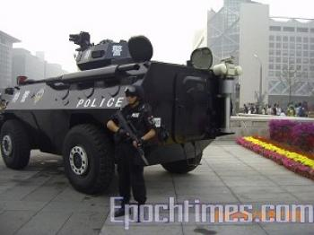 Armed police and armored vehicle on street of Beijing. (The Epoch Times)