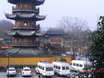 Police vehicles line up outside Longhua Temple.  (The Epoch Times)