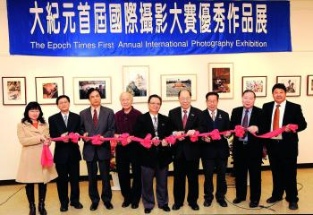 Members of the opening committee cutting a ribbon at The Epoch Times First Annual Photography Exhibition, held over the weekend. (Edward Dai/The Epoch Times)