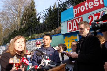 Sophia Bronwen speaks at a press conference at the Falun Gong protest site outside the Chinese consulate in Vancouver on Wednesday.  (Christine Liao/The Epoch Times)