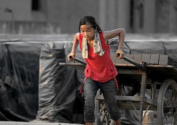 15-year-old Zhang Qianqian works 12 hours a day in a brickyard in rural China during summer vacation. (Chinese blogger)