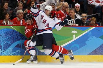 U.S. defenseman Brian Rafalski contains Canadian forward Eric Staal. (Bruce Bennett/Getty Images)