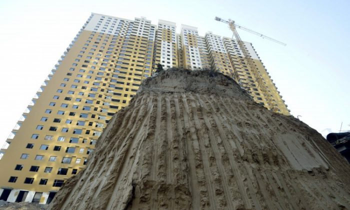 A grave mound 10 meters high at a construction site in a village in Taiyuan, north China's Shanxi Province, Dec. 6. Real estate developers in China are stuck with enormous inventories and no easy way in sight to offload them and avoid losses. (STR/AFP/Getty Images)