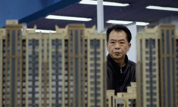 A potential buyer visits the 2011 Beijing Spring Real Estate Trade Fair on April 9, 2011 in Beijing. Officials with real estate whose provenance may not hold up under scrutiny are now hurriedly selling off their holdings, according to recent reports. (Lintao Zhang/Getty Images)