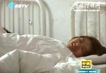 Deng Yujiao, when she was locked in a psychiatric hospital. (Screen grab from Enshi City TV/The Epoch Times)