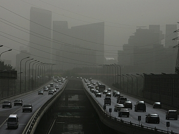 Vehicles drive on a street shrouded with smog in Beijing, China. Pollution levels in Beijing hit the top of the scale in late May, prompting a government warning for residents with respiratory problems to stay indoors. (Guang Niu/Getty Images)