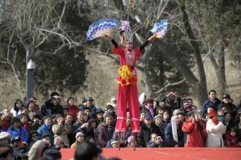 Walking on stilts. (AFP/Getty Images)