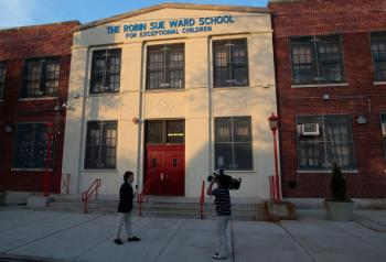 A television news crew reports from outside the Robin Sue Ward School for Exceptional Children April 28, 2009 in the Queens borough of New York City. The school is in the neighborhood of Fresh Meadows, not far from St. Francis Prep where the first cases o (Chris Hondros/Getty Images)