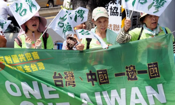 "Anti-China demonstrators displays banners reading ""one Taiwan, one China "" in Taipei on August 8. Taiwanese have a poor impression of mainland Chinese people, the Chinese government, and its human rights record, according to a new survey. (Sam Yeh/AFP/Getty Images)"