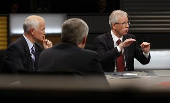 Liberal leader Stephane Dion (R) speaks as NDP leader Jack Layton (L) and Prime Minister Stephen Harper look. (Chris Wattie/AFP/Getty Images)