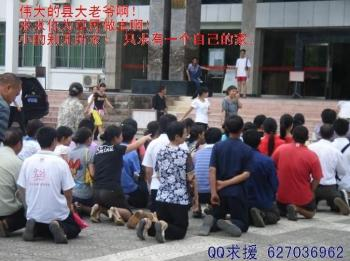Families appeal on their knees outside the town government building. The caption reads 'Mighty County officials, please take care of us civilians! We are so insignificant, but all we want is our own homes!' (Provided by the appellant)