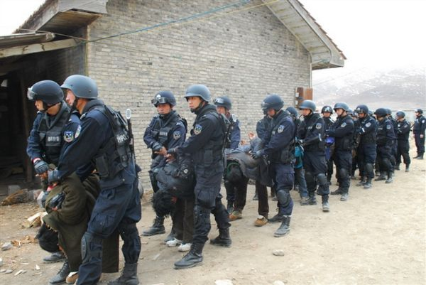 Tibetans' are forced to bow down as they are taken away by Chinese security forces