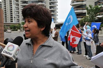 Ms. Mukerrem Kurban, the spokesperson for the protest in Calgary, Canada. (Wu Weilin/The Epoch Times)