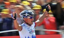 Ivanov Attacks Late to Win Stage Fourteen of the Tour