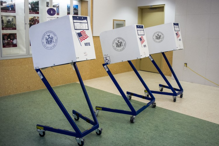 Empty voting booths at a public school in the Financial District on Sept. 13. (Benjamin Chasteen/The Epoch Times)